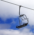 Chair-lift and cloudy sky - PhotoDune Item for Sale