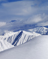 Top of off-piste snowy slope and cloud mountains - PhotoDune Item for Sale