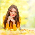 Cute woman laying in autumn park - PhotoDune Item for Sale