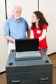 Young Volunteer Helps Voter - PhotoDune Item for Sale