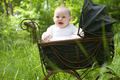 Happy baby in vintage pram - PhotoDune Item for Sale