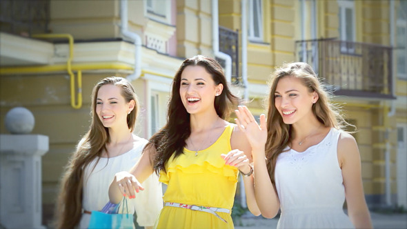 Three Girls Looking At Shopping