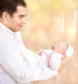 Happy father with newborn daughter - PhotoDune Item for Sale