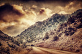 Grunge photo of road in the mountains - PhotoDune Item for Sale