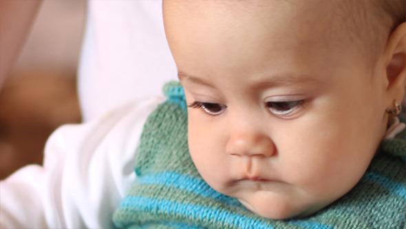 Pensive Little Baby Girl