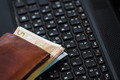 Wallet and  money on keyboard - PhotoDune Item for Sale