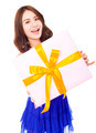 pretty young woman holding a gift box over white background - PhotoDune Item for Sale