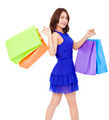 smiling young woman walking and  holding shopping bags over white background - PhotoDune Item for Sale