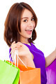 closeup of smiling young woman holding shopping bag over white background - PhotoDune Item for Sale