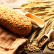 Rye spikelets and bread still life on wooden background - PhotoDune Item for Sale
