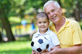 happy grandfather and child in park - PhotoDune Item for Sale