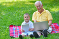 grandfather and child using laptop - PhotoDune Item for Sale