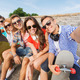 group of smiling friends with smartphone outdoors - PhotoDune Item for Sale