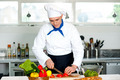 Chef carefully chopping vegetables - PhotoDune Item for Sale