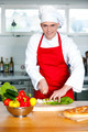 Chef chopping vegetables in kitchen - PhotoDune Item for Sale
