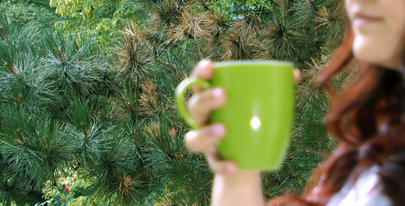 Young Girl Drinking Coffee and Nature