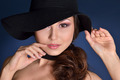 head of a beautiful woman in a black hat. - PhotoDune Item for Sale
