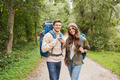 smiling couple with backpacks hiking - PhotoDune Item for Sale
