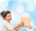 smiling little girl with gift box - PhotoDune Item for Sale
