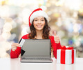 smiling woman with credit card and laptop - PhotoDune Item for Sale