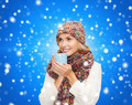 smiling young woman in winter clothes with cup - PhotoDune Item for Sale
