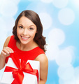 smiling woman in red dress with gift box - PhotoDune Item for Sale