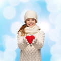 dreaming girl in winter clothes with red heart - PhotoDune Item for Sale