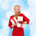 smiling woman in red dress with gift boxes - PhotoDune Item for Sale