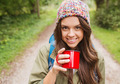 smiling young woman with cup and backpack hiking - PhotoDune Item for Sale