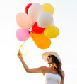 smiling young woman in sunglasses with balloons - PhotoDune Item for Sale