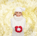 smiling woman in winter clothes with snowflake - PhotoDune Item for Sale