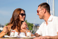 smiling couple eating dessert at cafe - PhotoDune Item for Sale