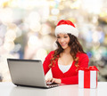 smiling woman with gift box and laptop - PhotoDune Item for Sale