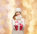 dreaming girl in winter clothes with gift box - PhotoDune Item for Sale