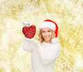 smiling woman in santa helper hat with red heart - PhotoDune Item for Sale