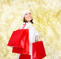 smiling young woman with red shopping bags - PhotoDune Item for Sale