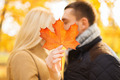 close up of couple kissing in autumn park - PhotoDune Item for Sale