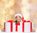 smiling girl in santa helper hat with gift boxes - PhotoDune Item for Sale