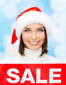 smiling woman in santa helper hat with sale sign - PhotoDune Item for Sale