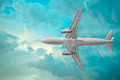 Passenger airplane in the beautiful cumulus clouds - PhotoDune Item for Sale