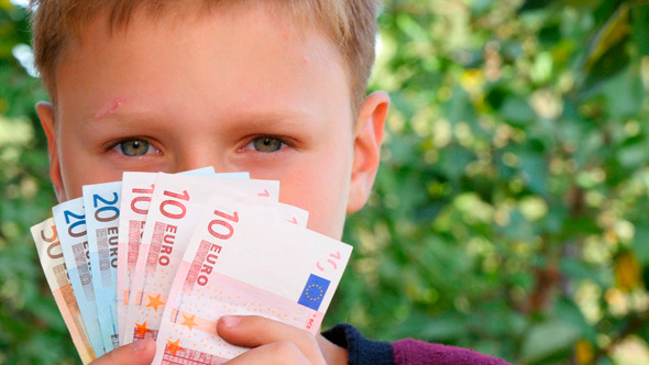 Boy Smelling Euro Notes 2