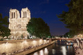 Notre Dame cathedral at night with people - PhotoDune Item for Sale