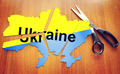 Cut map of Ukraine. Concept of disintegration of the country - PhotoDune Item for Sale