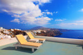 Two deckchairs on the roof. Santorini island, Greece - PhotoDune Item for Sale