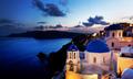 Oia town on Santorini island, Greece at night. Rocks on Aegean sea. - PhotoDune Item for Sale
