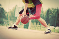 Young man on basketball court dribbling with ball. Vintage mood - PhotoDune Item for Sale