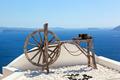 Old craftsmanship machine on the roof. Santorini island, Greece - PhotoDune Item for Sale