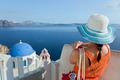 Happy tourist woman on Santorini island, Greece. Travel - PhotoDune Item for Sale