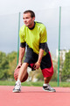 Young man on basketball court dribbling with ball - PhotoDune Item for Sale