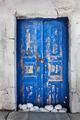 Grunge old blue door in Oia town, Santorini, Greece - PhotoDune Item for Sale